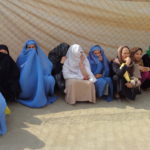 Burqa women fence