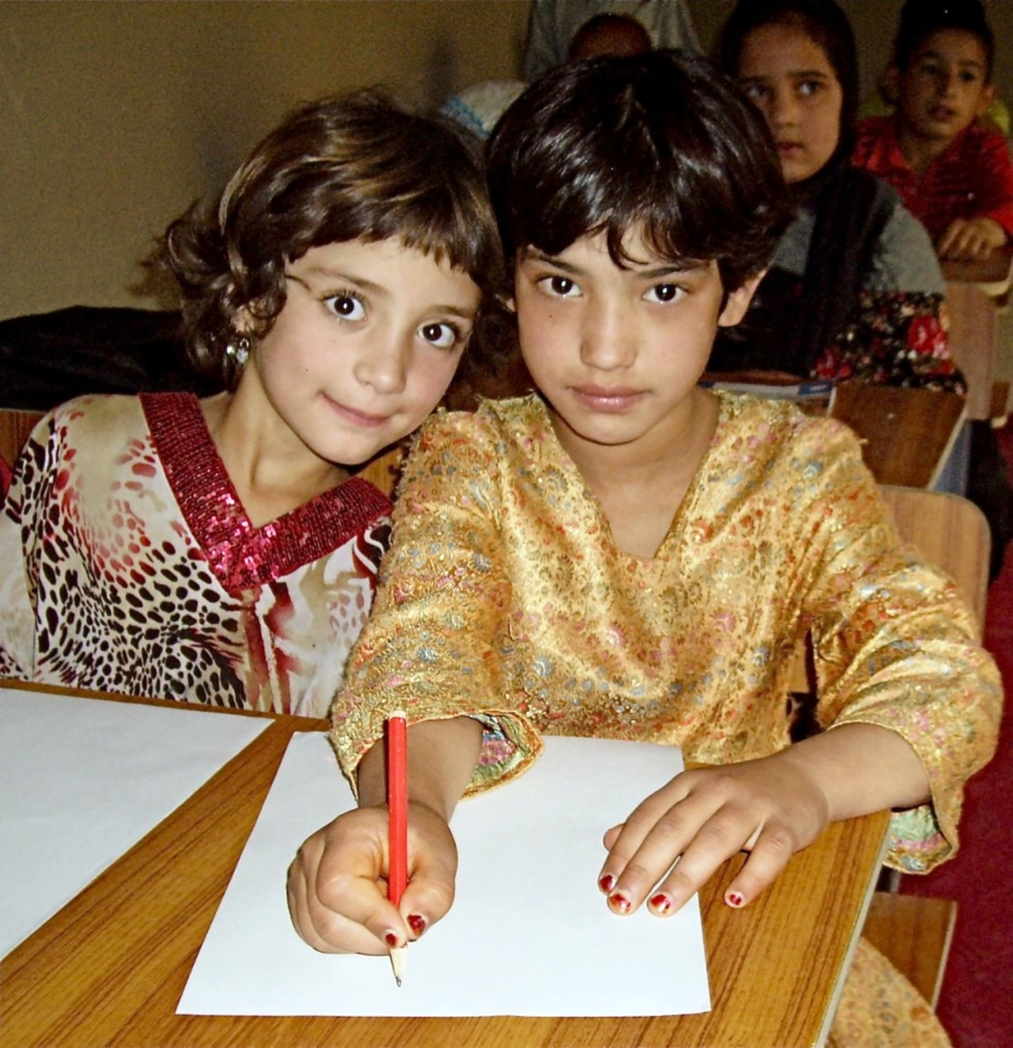 Two girls at a desk, cu